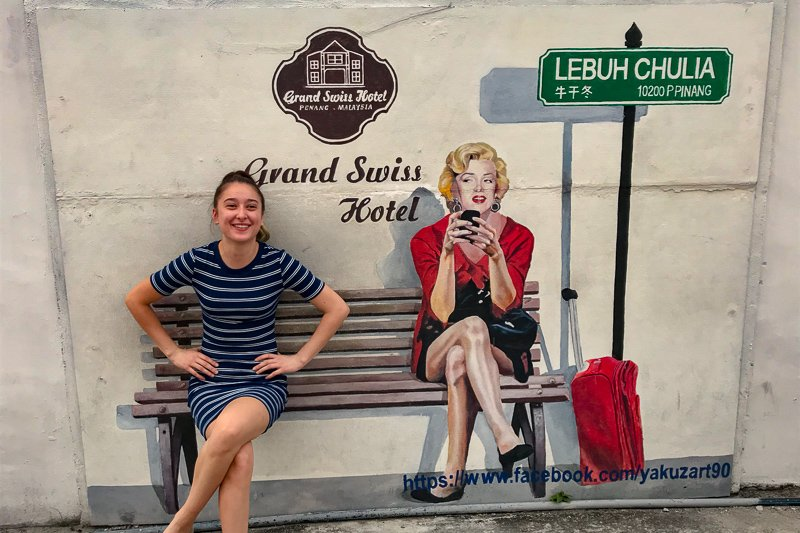 Penang street art, woman sitting on a bench, Malaysia