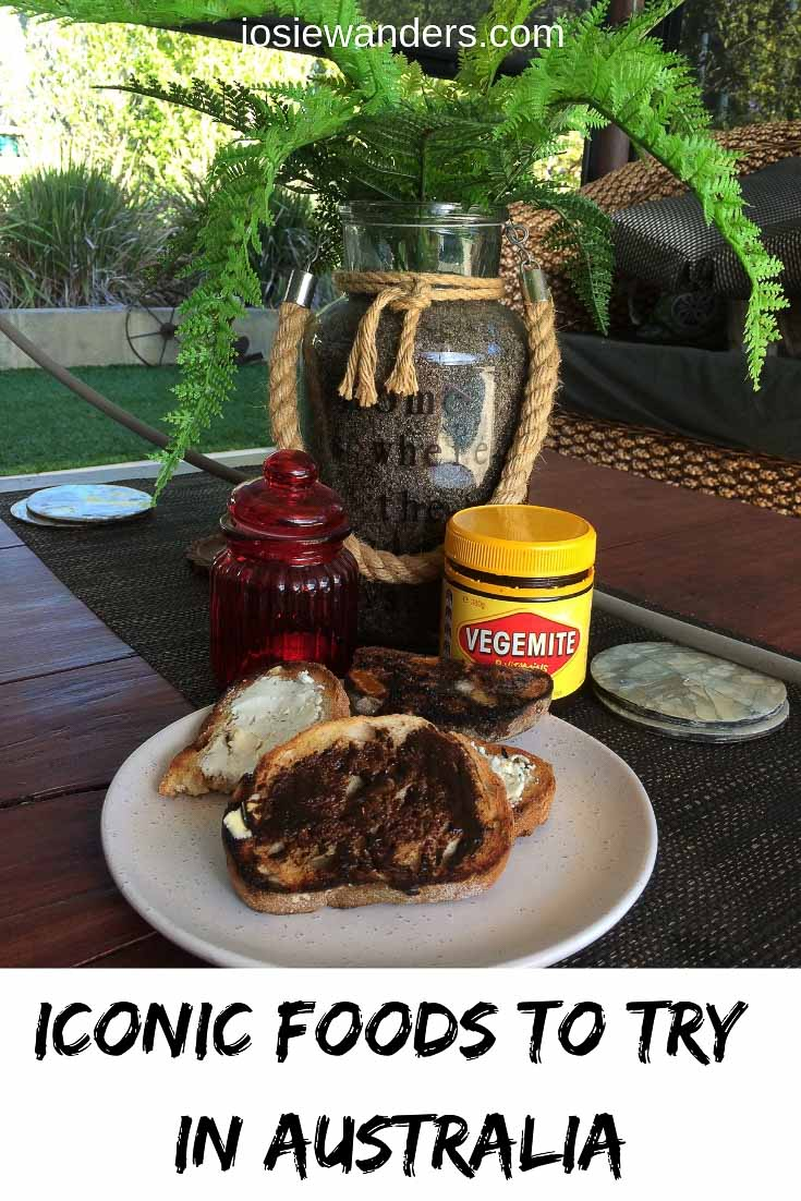 Iconic Foods to Try in Australia pin image. Plate of vegemite on toast on table in front of plant